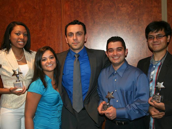Alumni Association President Vullnet Kolari [center] with the 2010 CSIAA Student Leadership Awardees