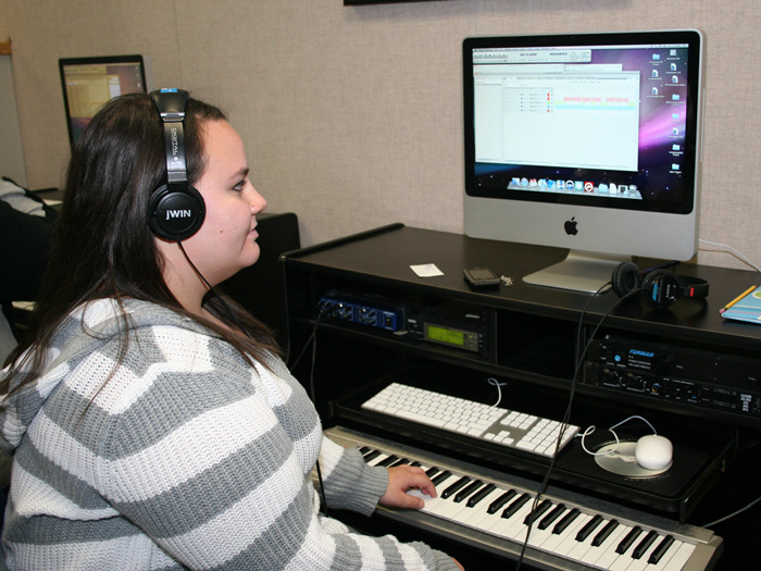 CSI Music student Christina Puliafico works with one of the Music Lab's ten new Macintosh computers.
