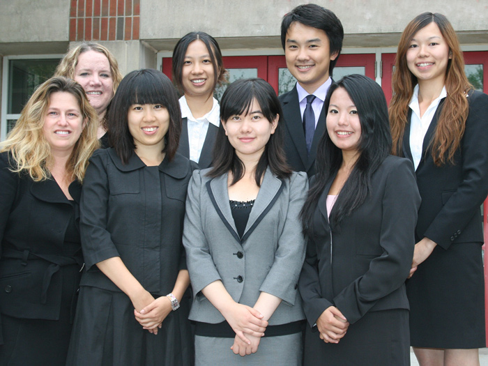 Victoria Cox and Barbara Clark (far left) pose with the six City University of Hong Kong students.