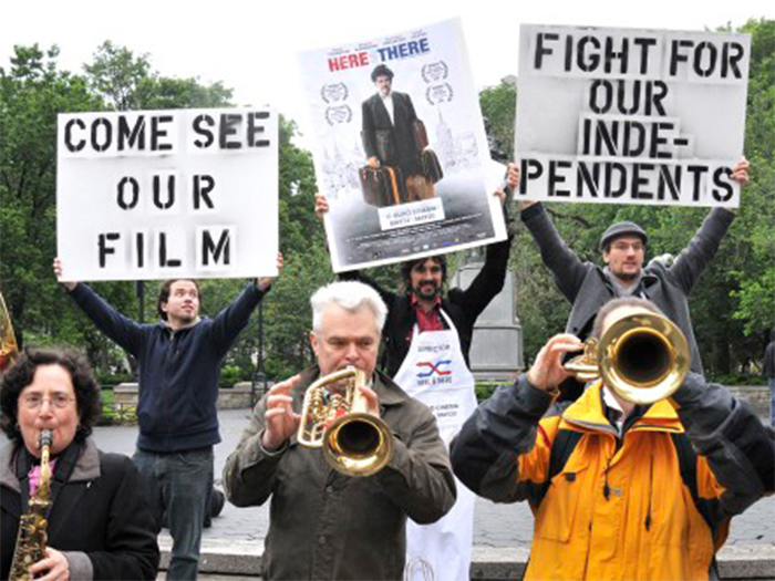 Supporters of Here and There trumpet the film's merits in New York City's Washington Square Park.