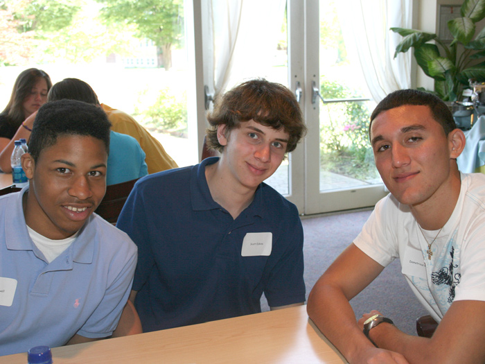 Three new Macaulay Honors College students pose for a picture during a brunch in the 1C Park Café.