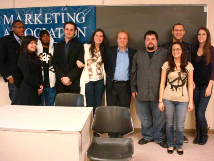 Members of the CSI Marketing Association met with alumna Janine LeChillgrien (fifth from left).