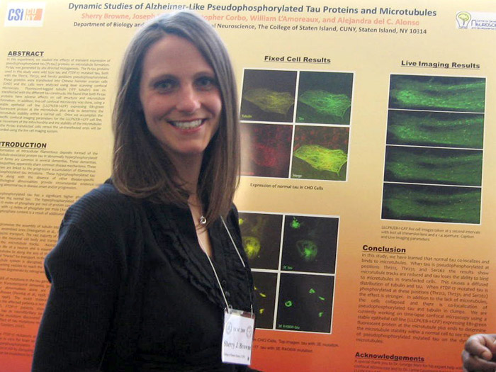 Sherry Browne poses in front of her award-winning poster at the Eastern Colleges Science Conference.