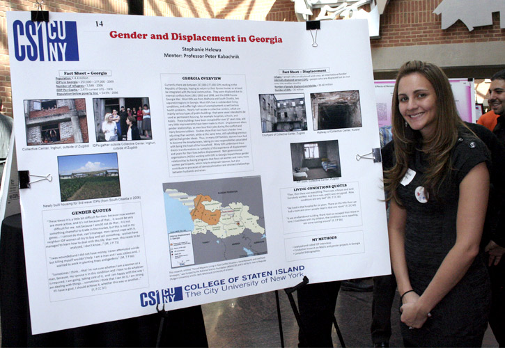 Elementary Education major Stephanie Helewa stands in front of her poster at the Conference.